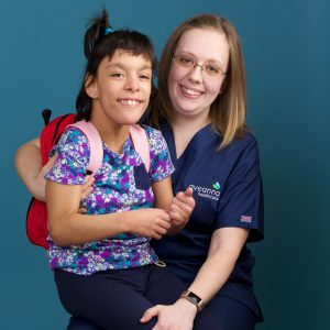 Nurse with disabled child | Aveanna.com