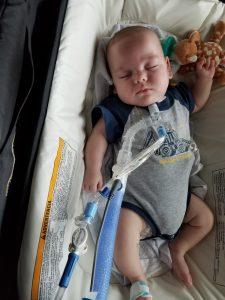 William asleep in crib